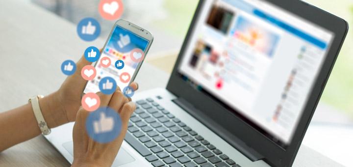 redes sociales manos laptop celular